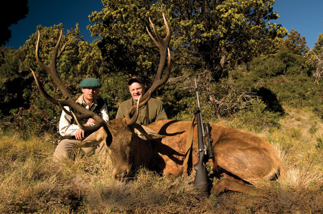 Craig Boddington, and his guide Cano St. Antonin, with a fine red stag taken on the Huemul Peninsula.